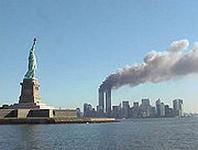 180px-national_park_service_9-11_statue_of_liberty_and_wtc_fire1